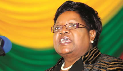 Zimbabwe Vice-President Mujuru blasts retrogressive political parties that are stalling progress at Chisumbanje Ethanol Plant while officially closing the third biennial Zimbabwe Local Government Conference in Mutare on May 11, 2013. by Pan-African News Wire File Photos