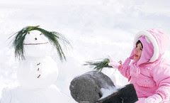 Snowman and little girl in central park
