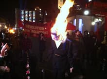 Demonstrators set fire to an effigy of Stephen Harper at a G20 protest in Montreal.
