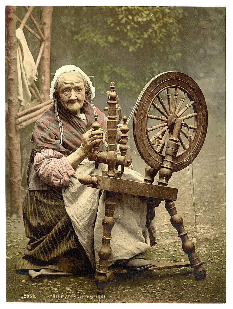 Irish spinner and spinning wheel. County Galway, Ireland
