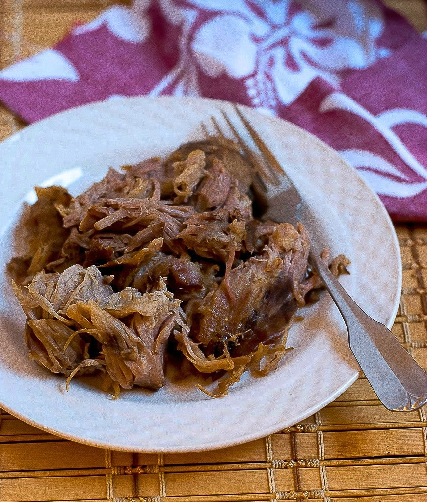 Hawaiian Style Slow Cooker Kalua Pork www.pineappleandcoconut.com  Just like what you have a luau without having to dig a pit in your yard to cook it!