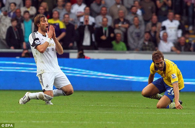 No! Michu is not happy with a refereeing decision and falls to his knees