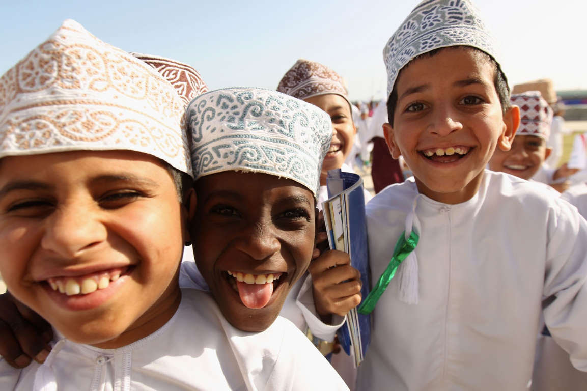 MUSCAT, OMAN - DECEMBER 15:  Local Omani school children soak up the atmosphere during the 2nd Asian Beach Games Muscat 2010 at Al-Musannah Sports City on December 15, 2010 in Muscat, Oman.  (Photo by Bryn Lennon/Getty Images)