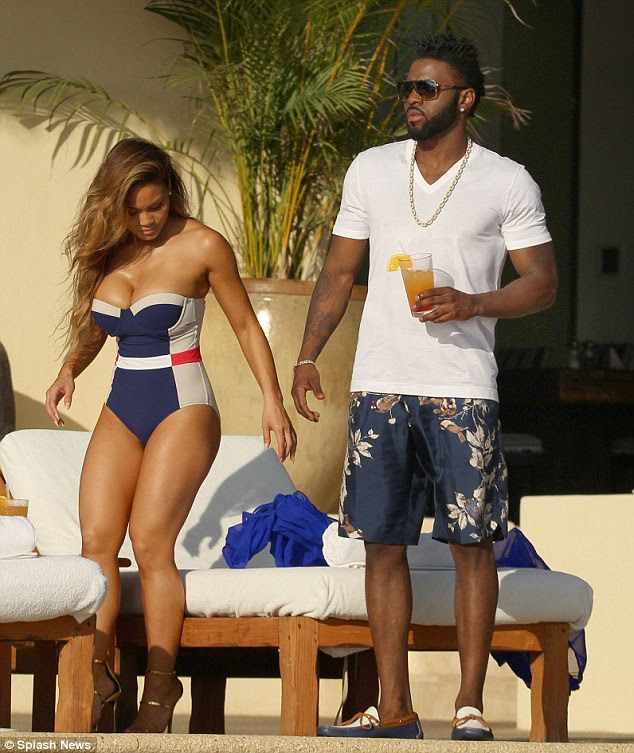 Poolside chic! Daphne, 28, wore gold stilettos with her curve-accentuating blue and cream one-piece
