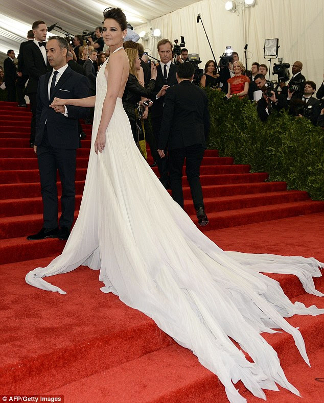Plumbing to new depths: Katie had fashion faux pas in her white gown as she attended the Metropolitan Museum of Art's Costume Institute Gala