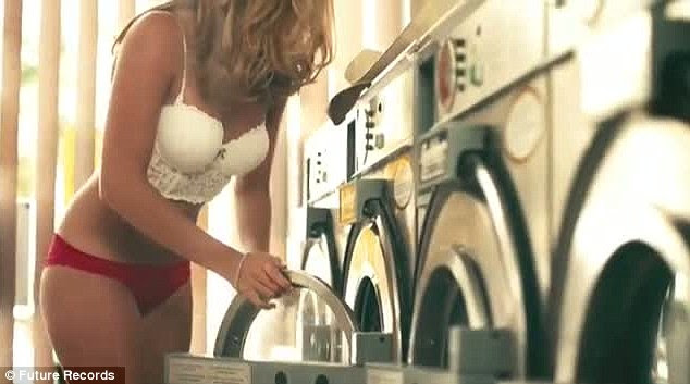 Saucy Caggie does her laundry dressed in just a pair of red underwear and a white bra as Charlie looks on