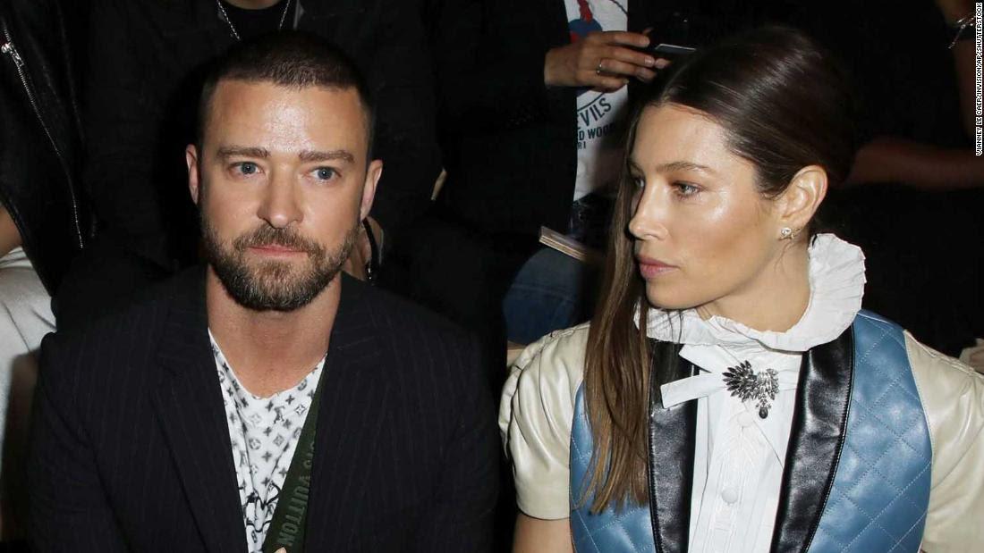 Justin Timberlake was grabbed by a prankster at Paris Fashion Week
