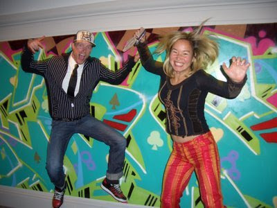 Mike Weber and Philippa Hughes jumping for joy in front of Tim Conlon's work