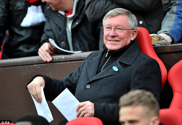 Big day: Sir Alex Ferguson was all smiles at the start of the game on the day of his 70th birthday