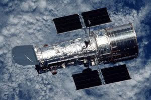 The Hubble Space Telescope following release from a space shuttle during a previous service flight.