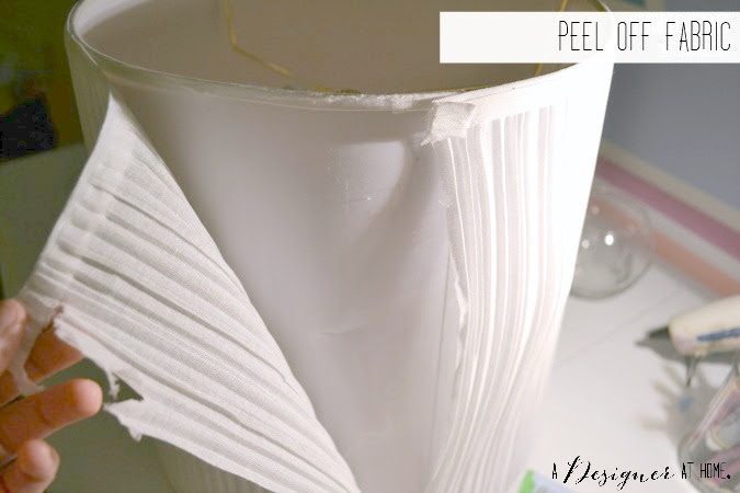 peel off fabric from lamp shade to create a base for the leather design