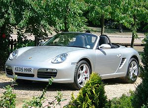 Porsche Boxster, a rear mid-engine, rear-wheel...