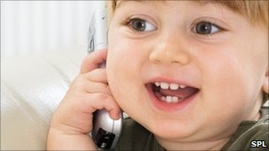 A toddler chatting on a mobile