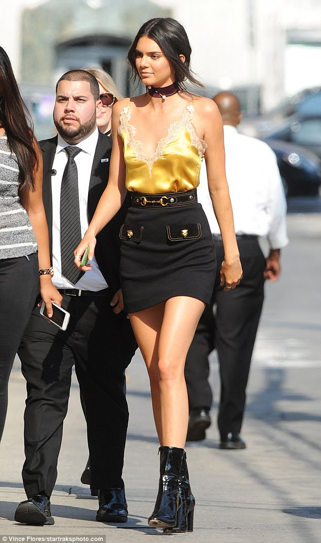 All shine: The modelrocked a lacy gold nightie top while heading to the appearance