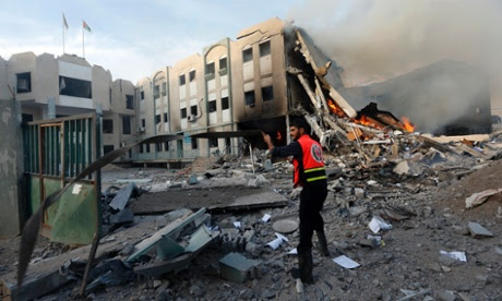 Palestinian firefighter tries to extinguish a fire after an Israeli air strike on the building of Hamas ministry of interior in Gaza City