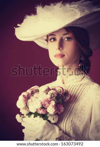 Beautiful redhead women with bouquet