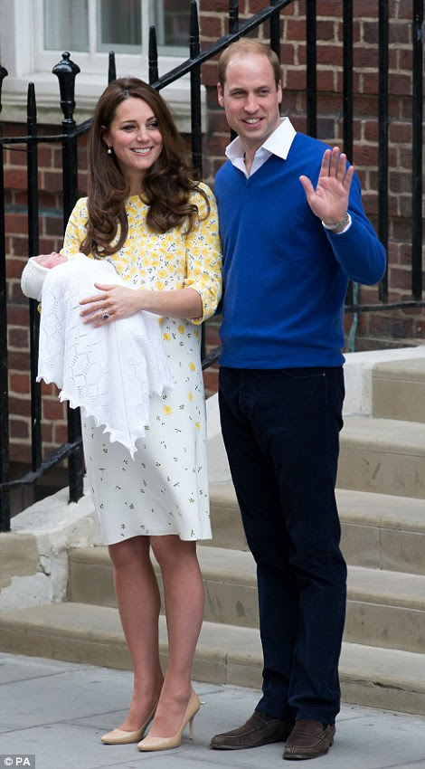William waved proudly to those who had waited to see the new baby while he put an affectionate arm around his wife