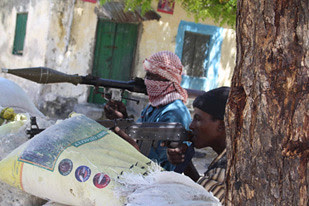 Fighters from the al-Shabab resistance group in Somalia. The US-backed government in Djibouti has announced that it will deploy 450 troops to AMISOM. The American military has a base in the country. by Pan-African News Wire File Photos