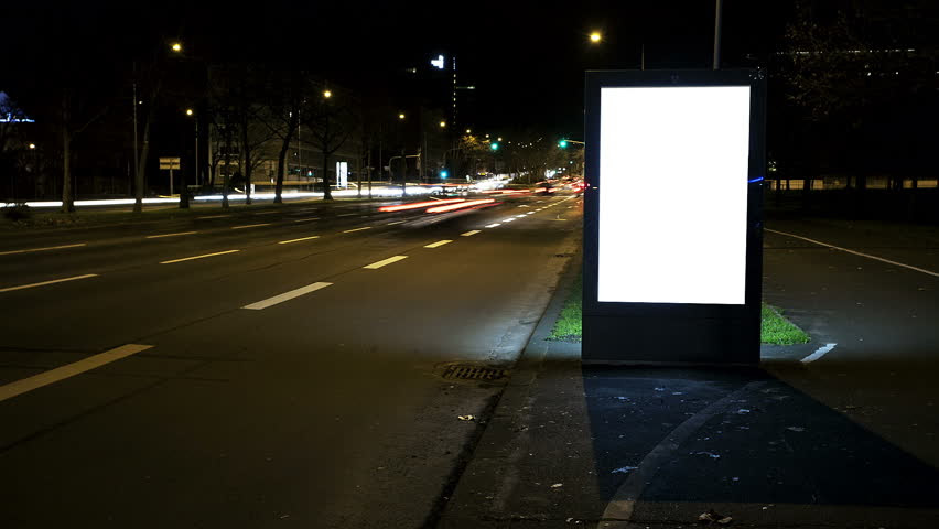Illuminated Blank Billboard - In The Background Traffic. Time ...