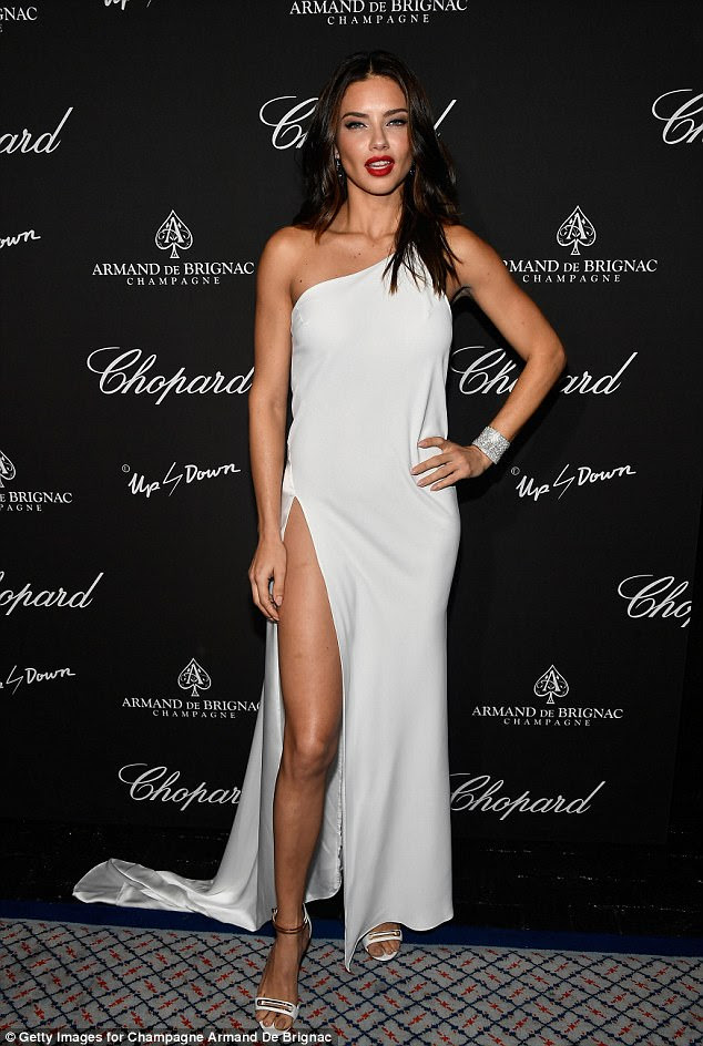 Hello, gorgeous: Adriana, the longest-serving current Victoria's Secret Angel, flashed a bit of leg in a white split gown with a bit of a train