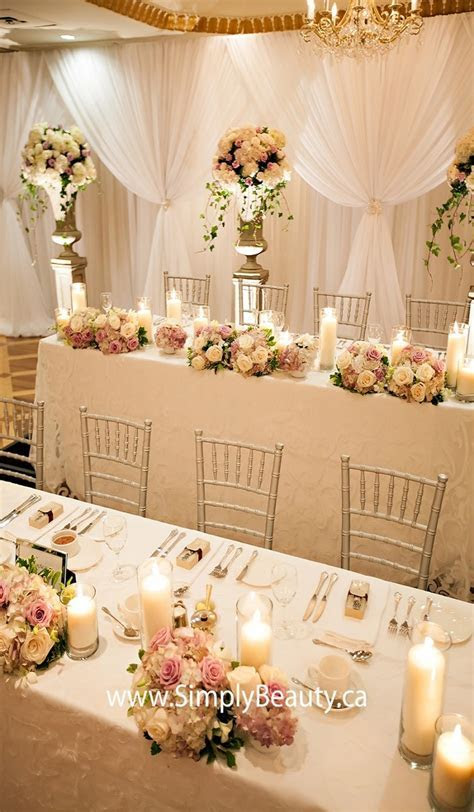 low centerpieces and chiavari chairs with a white on white