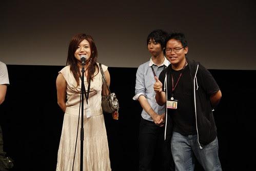 Director Lisa Takeba giving a speech (while I pose)