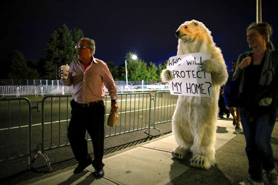 An activist dressed up as a bear walks outside Hofstra University where the first presidential debate at Hofstra University will take place in Hempstead, New York on September 26, 2016.