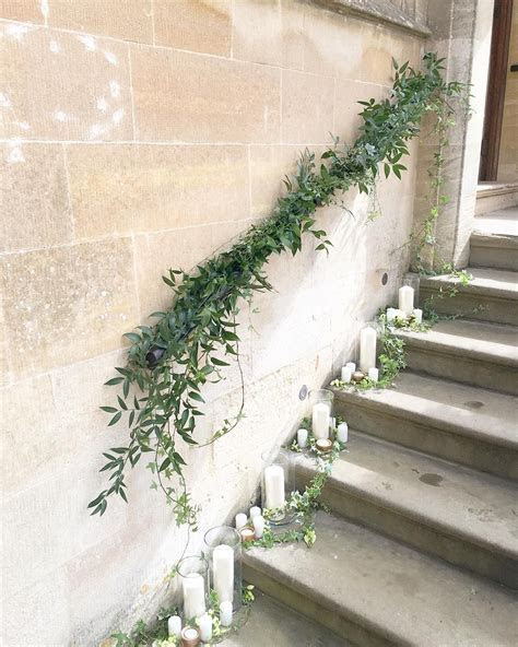 Foliage staircase garland and pillar candles   wedding