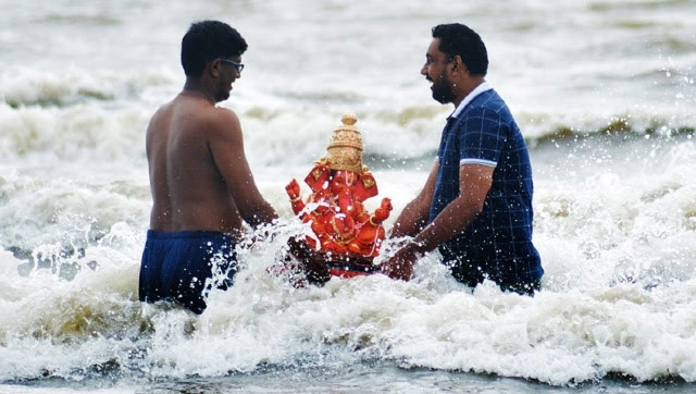 Amid high security due to the coronavirus pandemic, devotees across Maharashtra participated in the immersion of Lord Ganesh (Ganpati Visarjan) to bid farewell to the elephant-headed god on Sunday, 19 September, 2021. PTI