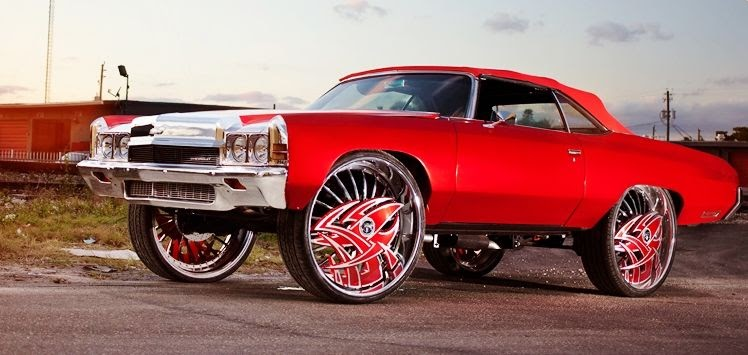 """Ace-1: Candy Red Chevy Vert on 32"""" DUB Razz Floaters"""