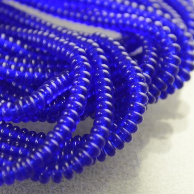 s36371 Glass Beads - 4 mm Tire Rondelles - Dark Sapphire (Strand 100)