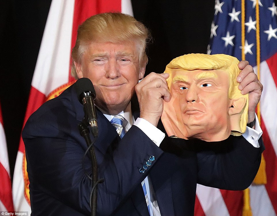 Midway through a speech lambasting Mrs Clinton's star supporters Jay Z and Beyonce for their crude language, Mr Trump broke off to indulge in some brief levity as he admired a latex mask of himself brandished by a fan in Sarasota, Florida