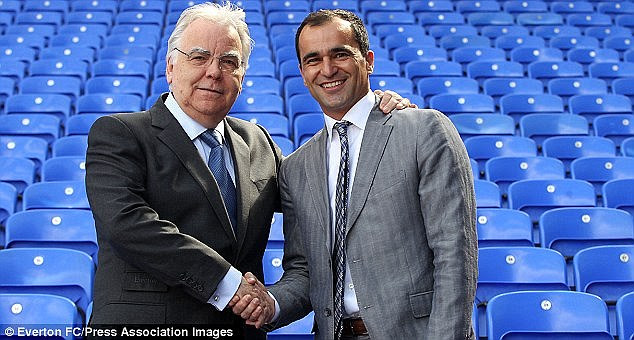Martinez shakes hands with Everton chairman Bill Kenwright after being appointed Everton manager