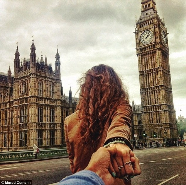 Hand-in hand in front of the clock's hands: Murad is led past the iconic sights of the Houses of Parliament and Big Ben in London