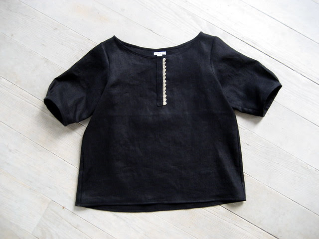 black linen top with vintage trim.