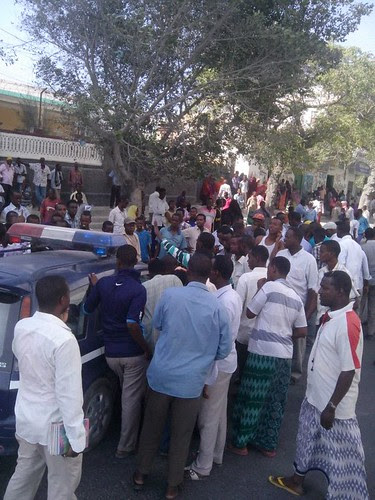 Somalians express outrage at the AMISOM accident on Jan. 28, 2014 which killed a taxi driver at a marketplace in the capital of Mogadishu. by Pan-African News Wire File Photos