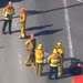 In a video frame grab, fire and rescue personnel gathered at Los Angeles International Airport on Friday.