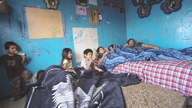 A family in the First Nations community of Pikangikum in northwestern Ontario. Overcrowding is a major problem on many reserves, where housing is in short supply and living conditions often substandard. The image is from a report by Coleen Rajotte for the CBC web series 8th Fire, which will launch in December. A documentary series of the same name will begin airing Jan. 12 on CBC television and Radio-Canada.