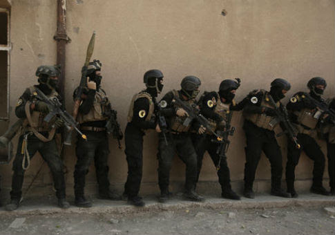 Iraqi special operations troops during a training exercise before the fight to retake Mosul, Iraq / AP