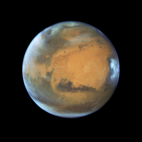 This global view of Mars was captured by the Hubble Space Telescope on May 12, 2016 ahead of the planet's arrival at opposition on May 22. The wide view lets scientists observe how climate impacts the entire planet.