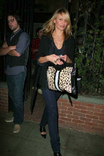 Cameron Diaz carrying L.A.M.B. Signature Carlisle Convertible Clutch Tote in Leopard