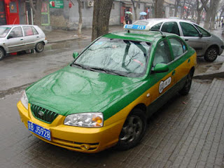 Beijing Taxi in a hutong