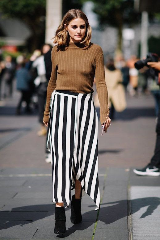 Le Fashion Blog Olivia Palermo LFW Camel Colored Mock Neck Sweater Bold Black White Striped Skirt Black Boots Via Popsugar