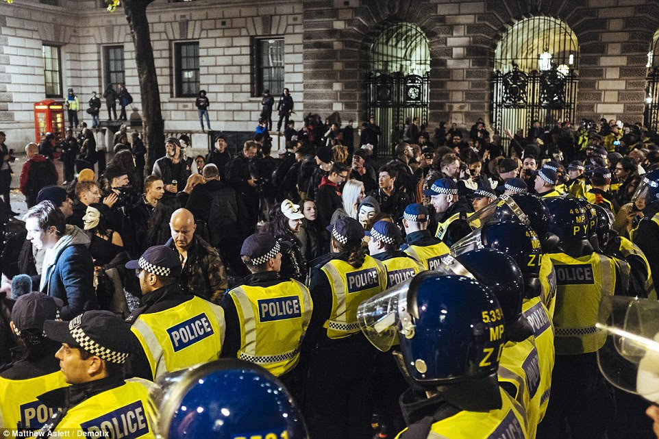 Thousands of protesters rampaged through London, launched missiles at police who formed a barricade as they controlled the crowd