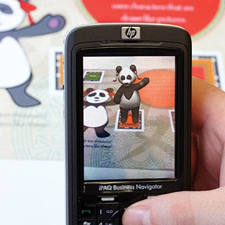 A book with special embedded pictures/codes and a cell phone with a camera is all you need to learn Mandarin from a 3D panda