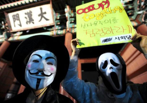 Manifestantes usam máscaras de Guy Fawkes em protesto na Coreia do Sul (Foto: Park Ji-Hwan/AFP)