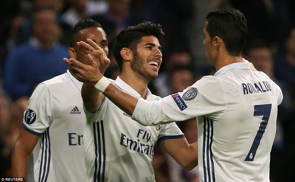 The 20-year-old Spaniard looks delighted as he takes the embraces of the man who set up his just his eighth Real Madrid goal