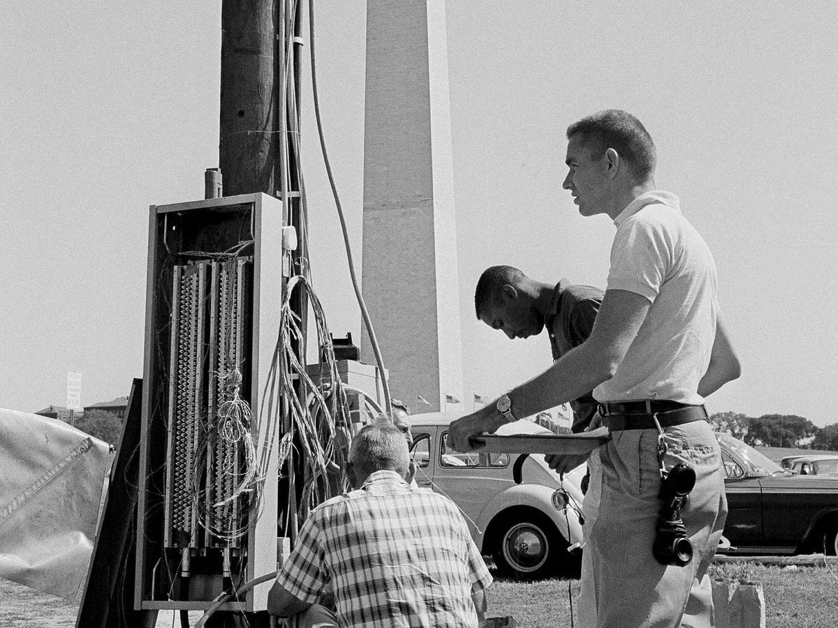More than 100,000 people were expected to attend the march. Here, workmen install extra telephone poles to uphold general communication at the event.