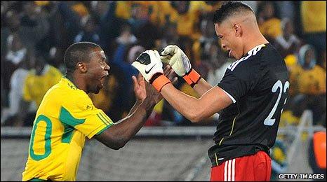 Aaron Mokoena (left) celebrates with Moeneeb Josephs