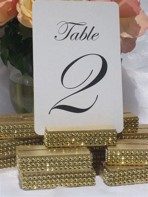 Gold Wedding Table Number Holder Trimmed with a Gold